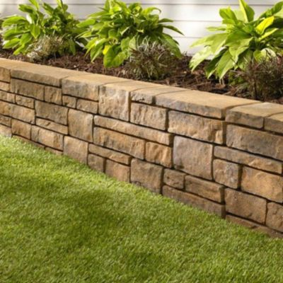 Brown Retaining Wall With Pavers That Vary In Size And Shape