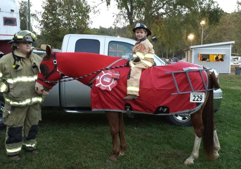 My son Issaac and his horse Cajun the fire truck.