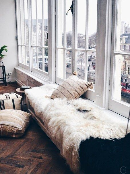 living -★- sheepskin rug large windows herringbone floor
