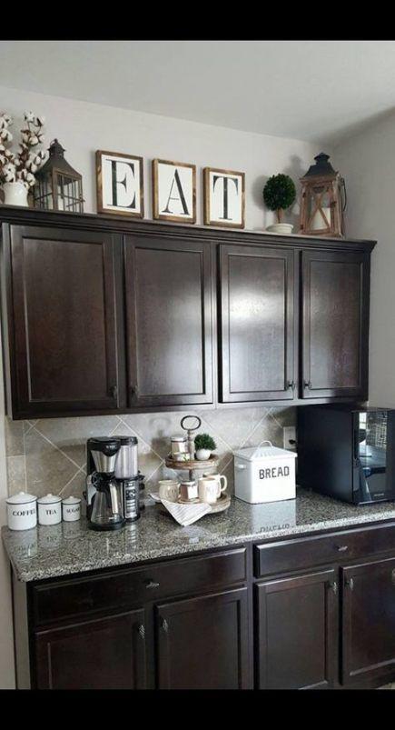 Kitchen rustic decor above cabinets 19 super ideas #kitchen ... on decorating tips above kitchen cabinets, wasted space above kitchen cabinets, interior decorating above kitchen cabinets,