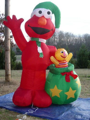 airblown elmo with santas bag and with elmos doll