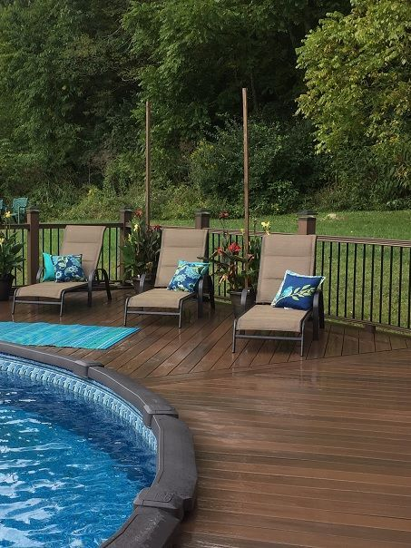 Above Ground Pool Deck Surround Composite Or Pvc Decking Is A Good Choice Over Wood Here S Why Above Ground Pool Landscaping Backyard Pool Pool Landscaping