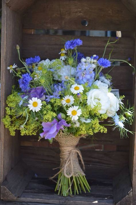 High summer wedding bouquet using cornflowers, lisianthus, alchemilla mollis, camomile, love-in-a- mist, delphinium, and sweet peas bound with string. Just picked, rustic wedding flowers. Wild & Wondrous Flowers