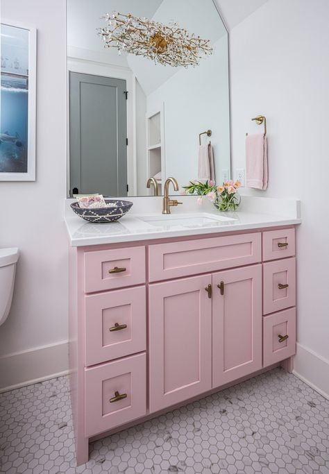 Adorable bubblegum pink bath vanity sits on marble hex floor tiles and is adorned with aged brass knobs and a white quartz countertop. Brown Bathroom, Small Bathroom, Light Bathroom, Bathroom Inspo, Bathroom Ideas, Pink Cabinets, Pink Vanity, Pink Baths, Romantic Home Decor