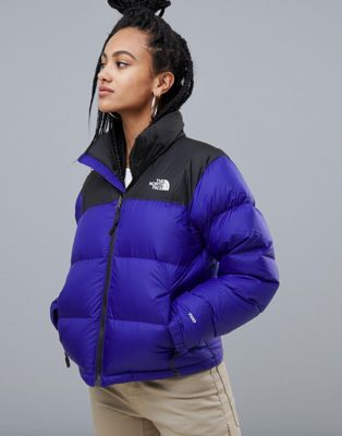 blue and black north face nuptse jacket