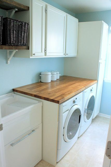 Laundry room: butcher block countertops, salvaged cabinets in Benjamin Moore Cloud Cover, open shelves, utility sink: Tanner Projects
