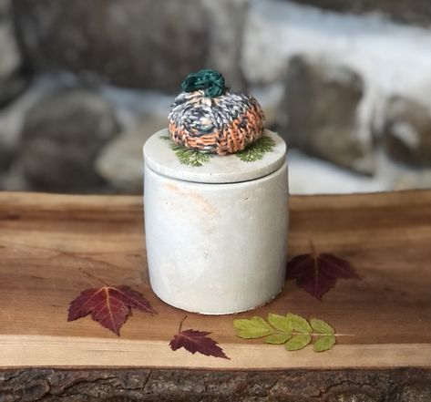 Hand knit pumpkins top this cute and unique fall themed concrete candle! The pumpkin is attached with Velcro and can be removed to use as decor when the candle vessel is empty. The pumpkins are filled with dry beans and are great stress relievers! Sweet pumpkin, apple, pear, cinnamon, clove, berries, and vanilla. Hand poured pure soy wax candle with lead free cotton wick, essential oils, and clean, fine fragrance oils, free from harmful phthalates, petroleum products/paraffin, hormone disrupters