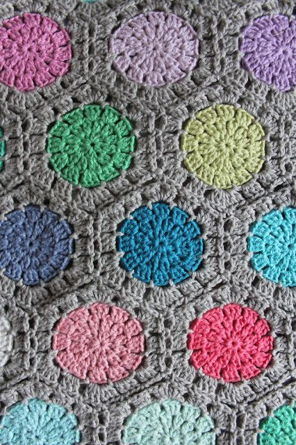 Pretty crochet pastel dotted blanket made by Karen Klarbæks' mother. I think she used the hexagon pattern by Attic24 here attic24.typepad.c...
