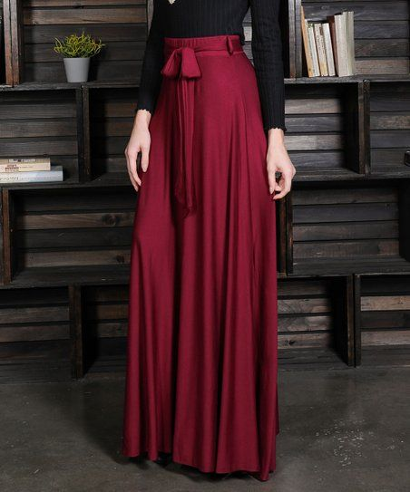 5b56625ff5 Refresh your wardrobe with this timeless maxi skirt boasting a flattering  tie-waist and solid hue for added versatility in styling.