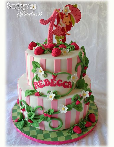 8 and 6 inch cakes. Fondant was flavored strawberry. Strawberry Shortcake is an edible image. Design inspiration came from the amazing Valerie of Sweet Picasso Cake Creations. Thank you Valerie for allowing me to use your design!