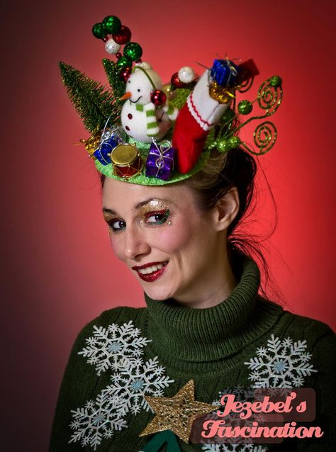Skip the ugly Christmas sweater and stand out wearing this gaudy fascinator with, Frosty, a stocking filled with gifts and so much more reminiscent of your childhood Christmas!  Please note frosty and the whimsical pieces in the back will be a little different than what is pictured :)