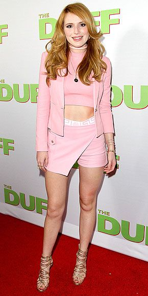 Last Night's Look: Love It or Leave It? Vote now! | BELLA THORNE | in a pink skort with embellished trim, matching crop top, jacket and choker, and gold scrappy sandals, all for a screening of The Duff in L.A.
