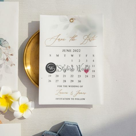 This is a save the date that is sure to impress with elegant botanical and calendar design. The vellum overlay adds a unique touch. #weddingideas#weddinginvitations#stylishwedd#vellumweddinginvitations#savethedate#weddingstationery