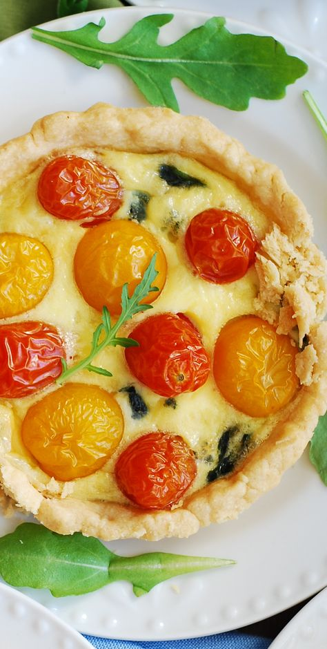 Spinach and cherry tomato breakfast quiche.  Delicious flaky crust that will melt in your mouth!