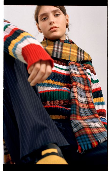 Ella in a Burberry bright red tartan and spot scarf paired with an amber yellow check scarf
