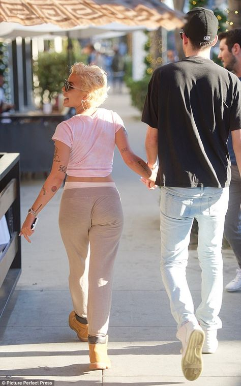 On a stroll: Halsey is known for her constant hair changes using wigs and extensions, but the showcased her natural short platinum blonde tresses while out for lunch