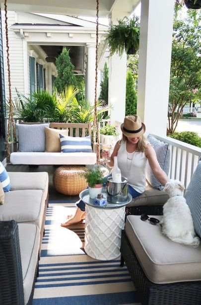Coastal Front Porch Creating A Lot Of Seating On Small