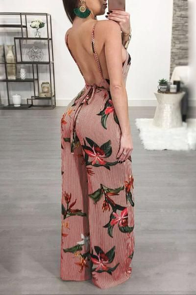 29178e3a031e Love the color combination of the background and floral print on this  backless jumpsuit.