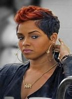 faux hawk , red hair lifted black sides, youth short hairstyle