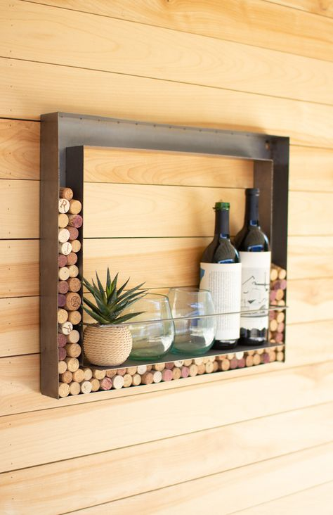 """Form meets function with this elegant wall bar. Store your wine bottles and glasses, and when you are done with your favorite wine, toss the cork into the frame for a fun collection! Small metal bar attached to keep shelf items in place. 22"""" x 2"""" x 18""""tCorks not included."""