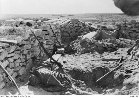 A dead Italian soldier lies behind the stone wall of an Italian defence position outside Bardia. North Africa, date unknown - pin by Paolo Marzioli