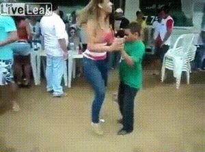 Small guy dances with women