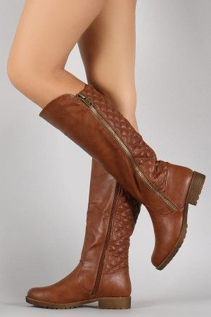 Description These knee high boots feature a quilted design shaft, rounded toe, side zipper trims, and low block heel. Finished with cushioned insole, soft inter
