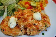 Salmon Patties use Panko or quinoa in place of bread.  Add any of the following for variation - corn kernels, capsicum, celery, soy sauce, paprika.