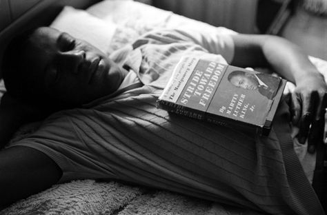 A Freedom Rider sleeps at a safe house, his copy of Dr. King's Stride Toward Freedom close at hand, in Montgomery, Alabama, in 1961.