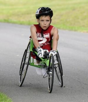 inspiring story of a 10 year old with spina bifida who completed the boilermaker - the youngest to complete the 15k in a wheelchair