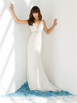 Guipure lace bridal gown with hand beaded inset waistband and dramatic back detail. After Six by Dessy.