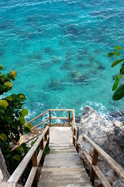 stairs to the ocean (Curacao) by Jim Covert