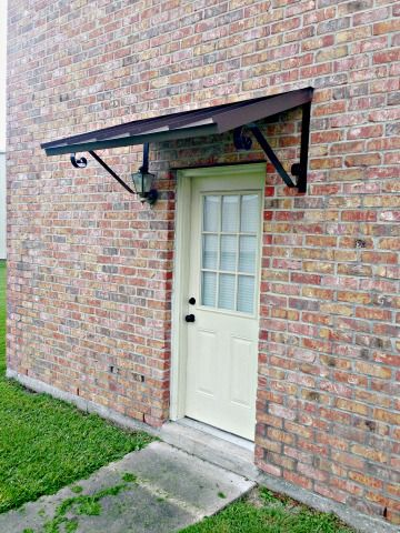 The Classic Metal Door Awning In Bronze With The Single S Scrolls Custom Awnings Metal Door Awning House Awnings