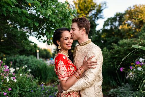 Happy bride and groom embrace in flower field after their Chicago Indian wedding