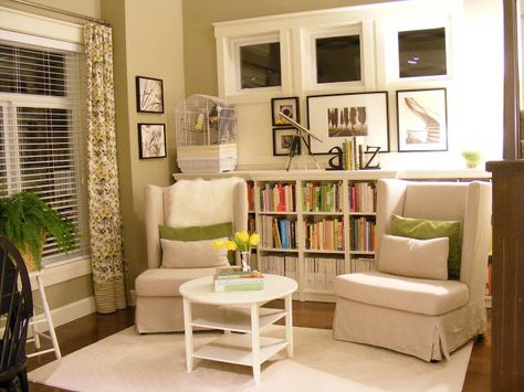 Library Nook with bookshelf behind chairs - Maillardville Manor
