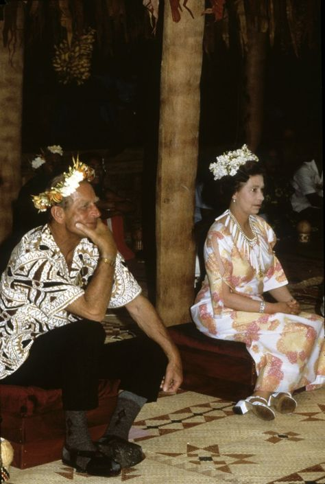 Queen Elizabeth ll and Prince Philip wore flowers in their hair as they attended a traditional feast in Tuvalu on Oct. 27, 1982, during their tour of the South Pacific.