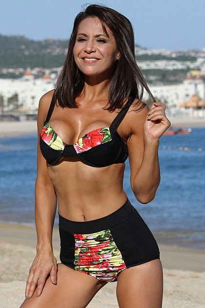 Two piece bathing suit with high waist retro style. Tropical fabric paired with slimming black, this designer swimsuit features suppostive underwire top and flattering high waist bottoms. Available in plus size.