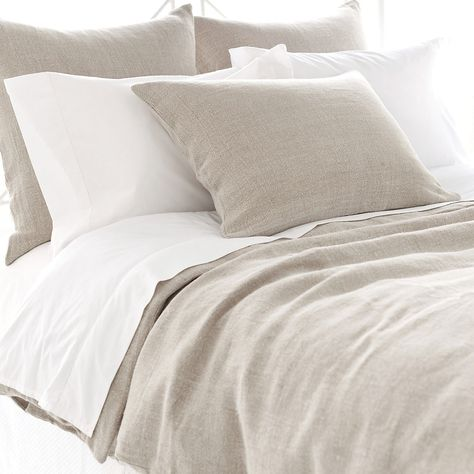 Pine Cone Hill Stone Washed Linen Bedding is made of 100% linen and offers either a tailored or a graceful ruffle approach to bed dressing.Duvet Cover has a knife edge with a hidden button closure.Tailored Sham has a knife edge with envelope back closure with ties.Ruffled Sham has 4