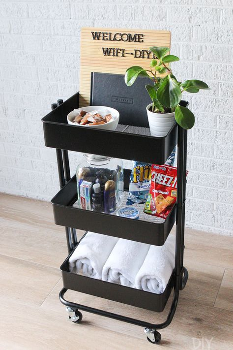 Use a rolling cart to hold guest room essentials. Love this idea to hold snacks, extra towels, toiletries, and even the wifi password! Come see more ideas to use this rolling cart in various rooms around your home! #rollingcart #guestroom #organized #organization