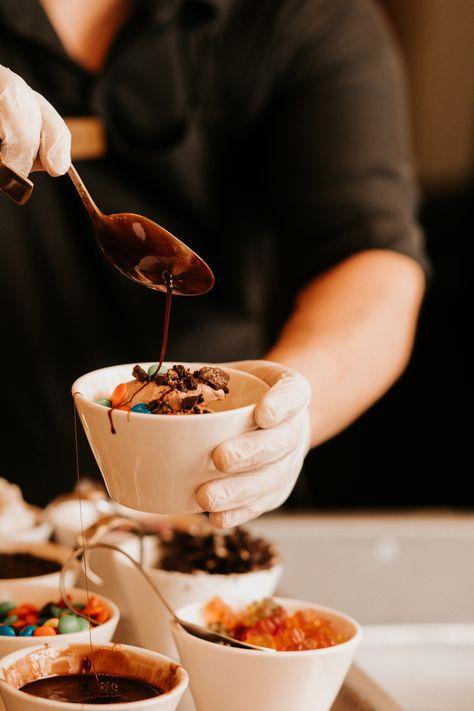 Chocolate and vanilla ice cream bar with an assortment of delicious toppings and sauces!! | Photo: Tori Kelner | Lakeside Wedding | Rock Island Lake Club | Sparta, NJ #RockIslandLakeClub #dessert #donut #donuts #dessertporn #desserts #diyicecreambar #icecream #chocolate #sundaes #icecreamsundae #candy #lakewedding #lakesidewedding #rusticwedding #engaged #NJbride #NJwedding #NJweddingvenue #weddingvenue #wedding #weddings #weddinginspo #weddingfood #NJweddings #bride #bridetobe