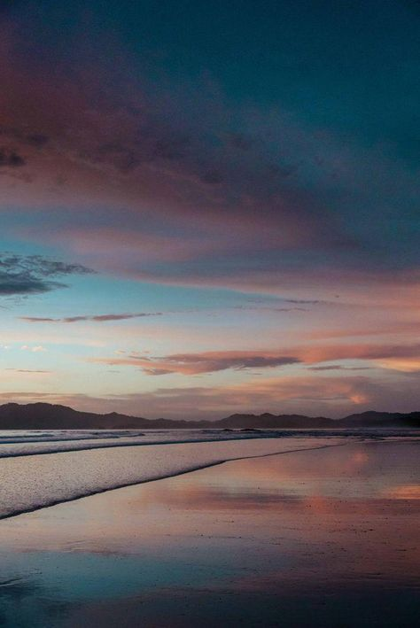 """When the sunset looks like a painting! Beautiful pink, purple, and turquoise blue sunset sky and reflections off the beach in Tamarindo Costa Rica. """"Paint the Sky"""" sunset print by Kristen M. Brown, Samba to the Sea at The Sunset Shop. #costarica #puravida #sunset #beachlife"""