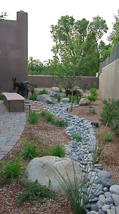 side garden landscaping treatment-love the donkies,they so complete the picture!