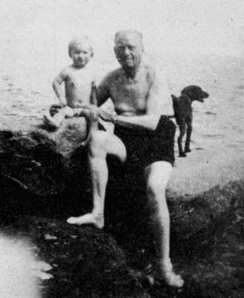 ALEISTER CROWLEY (1938? or 1940s) | On a beach in Cornwall with his son Randall Gair - nicknamed Aleister Ataturk - whose mother was Deirdre Patricia Doherty, grand-daughter of Thomas Cooper Gotch (Reproduced in Ithell Colquhoun's 'Living Stones')     ✫ღ⊰n