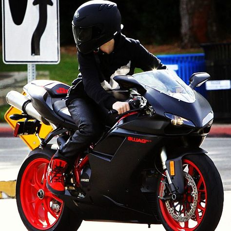 Black and Red Ducati...and a chick riding it! guys i just realized this was justin bieber...hahahaha wowwww