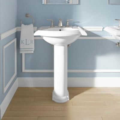 White Pedestal Sink In A Light Blue Bathroom With White Moulding And Mirror Hanging On The Wall Rectangular Sink Bathroom Pedestal Sink Modern Pedestal Sink
