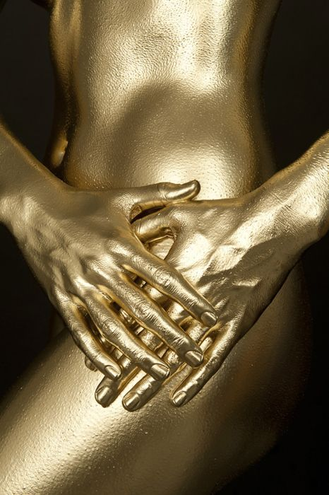 gold body paint becomes gold statue