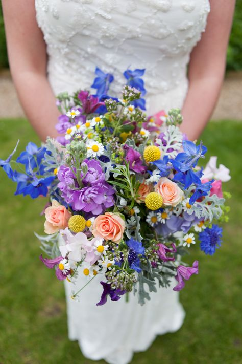 Rustic summer bouquet of spray peach roses, delphinium, stocks, rosemary, sweet peas, craspedia and daisies. Created by Eden Blooms Florist at Northbrook Park and photographed by Martin Price Photography
