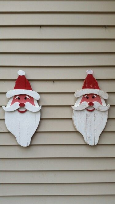 Santa's I made from pallet wood.  The one on the right I gave a more distressed look....