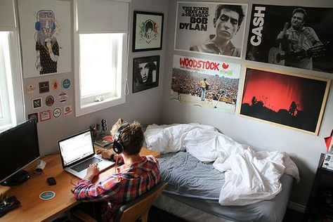 Another guy's dorm room. I like the simplicity of the four posters in a square pattern above the bed and the basic grey sheets and whi...