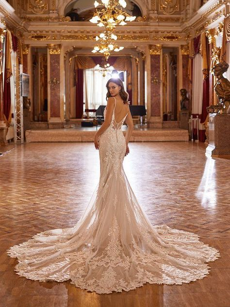 For our glamorous brides that love a little drama, fall in love with Val Stefani Style Dolce. This mermaid wedding gown features thin beaded straps and a deep illusion v-back with a elongated cathedral lace train finish, leaving you to look timeless as can be. #weddingdress #weddingdressideas #mermaidweddingdress #laceweddingdress